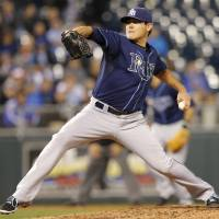 Photo - Tampa Bay Rays starting pitcher Matt Moore delivers to a Kansas City Royals batter during the third inning of a baseball game at Kauffman Stadium in Kansas City, Mo., Monday, April 7, 2014. (AP Photo/Orlin Wagner)