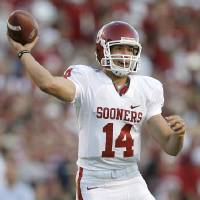 Photo - OU's Sam Bradford throws the ball in the second half during the college football game between the University of Oklahoma and Texas A&M University at Kyle Field in College Station, Texas, Saturday, November 8, 2008.  BY BRYAN TERRY, THE OKLAHOMAN   ORG XMIT: KOD