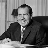 Photo - FILE - This Jan. 21, 1969 file photo shows President Richard Nixon at his desk at the White House in Washington. Nixon suffered a stroke in 1994 and died days later at age 81. Saturday, Aug. 9, 2014, marks the 40th anniversary of his resignation. (AP Photo/File)