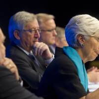Photo -   From left, President of the Financial Committee Thomas Wieser, Managing Director of the International Monetary Fund Christine Lagarde, Luxembourg's Prime Minister and President of the eurogroup Jean-Claude Juncker and European Commissioner for the Economy Olli Rehn participate in a media conference after a meeting of eurogroup finance ministers in Brussels, Tuesday, Nov. 27, 2012. The 17 European Union nations that use the euro have struck an agreement with the International Monetary Fund on a program to reduce Greek debt and put Athens on the way to get the next installment of its much-needed bailout loans. (AP Photo/Jock Fistick, Pool)