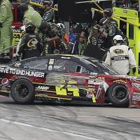 Photo - Jeff Gordon (24) heads to the garage after he brushed the wall during the NASCAR Sprint Cup series auto race at Texas Motor Speedway in Fort Worth, Texas, Sunday, Nov. 3, 2013. Gordon returned to the race after repairs to his car. (AP Photo/Brandon Wade)