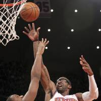 Photo - New York Knicks' Amare Stoudemire (1) shoots against Philadelphia 76ers' Lavoy Allen during the first half of an NBA basketball game, Sunday, Feb. 24, 2013, at Madison Square Garden in New York. (AP Photo/Mary Altaffer)