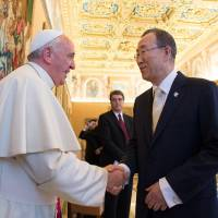 Photo - In this photo provided by the Vatican newspaper L'Osservatore Romano, Pope Francis greets U.N. Secretary-General Ban Ki-moon at the Vatican, Friday, May 9, 2014. Pope Francis called Friday for governments to redistribute wealth to the poor in a new spirit of generosity to help curb the