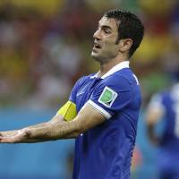 Photo - Greece's Giorgos Karagounis reacts during the World Cup round of 16 soccer match between Costa Rica and Greece at the Arena Pernambuco in Recife, Brazil, Sunday, June 29, 2014. (AP Photo/Ricardo Mazalan)