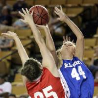 Photo - The East's Brooke Watkins (44) puts up a shot against the West's Jamie Brown during the All State Small School Girls Basketball game at Oral Roberts University in Tulsa, OK, July 25, 2012. MICHAEL WYKE/Tulsa World