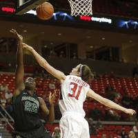 Photo - Baylor's Sune Agbuke (22) shoots over Texas Tech's Haley Schneider (31) during an NCAA college basketball game in Lubbock, Texas, Wednesday, Feb. 12, 2014. (AP Photo/The Avalanche-Journal, Tori Eichberger)