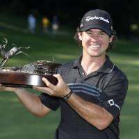 Photo - Brian Harman holds the 2014 John Deere Classic trophy after the golf tournament at TPC Deere Run in Silvis, Ill., Sunday, July 13, 2014. (AP Photo/Charles Rex Arbogast)