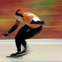 Photo - Sven Kramer, of the Netherlands, competes in the men's 5,000-meter speed skating race at the Adler Arena Skating Center during the 2014 Winter Olympics in Sochi, Russia, Saturday, Feb. 8, 2014. Kramer set a new Olympic record. (AP Photo/David J. Phillip)