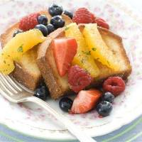 Photo - In this image taken on March 11, 2013, pan-seared pound cake with minty fruit salad is shown served on a plate in Concord, N.H. (AP Photo/Matthew Mead)