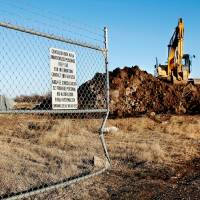 Photo - Contaminated soil is being stored behind several fenced acres where Blackwell Zinc Co. once stood. The soil is being taken there from poluted areas of Blackwell and then transfered to a landfill for disposal.  JIM BECKEL - THE OKLAHOMAN