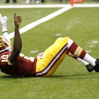 Photo -   Washington Redskins quarterback Robert Griffin III (10) reacts after throwing a touchdown pass in the first quarter of an NFL football game against the New Orleans Saints at Mercedes-Benz Superdome in New Orleans, Sunday, Sept. 9, 2012. (AP Photo/Bill Haber)