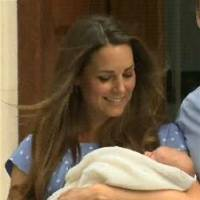 Photo - In this image from video, The Duke and Duchess of Cambridge leave the Lindo Wing of St Mary's Hospital in London Tuesday, carrying their new-born son, the Prince of Cambridge, who was born Monday, into public view for the first time. The boy will be third in line to the British throne. (AP Photo/APTN)