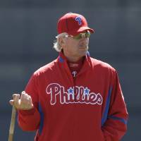 Photo - FILE - In this Feb. 26, 2010, file photo, Philadelphia Phillies spring instructor Mike Schmidt holds a bat during a spring training baseball practice in Clearwater, Fla. I just returned from Hall of Fame induction weekend, where I find that my cronies and I are slowly becoming the older generation of the membership.  (AP Photo/Eric Gay, File)