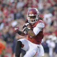 Photo - In this photo taken on Nov. 2, 2013, Arkansas wide receiver Keon Hatcher carries in the first half of an NCAA college football game against Auburn in Fayetteville, Ark. (AP Photo/Beth Hall)
