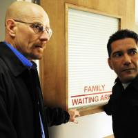 Photo - This 2009 image released by AMC shows actors Bryan Cranston as Walter White, left, and Steven Michael Quezada as Steven Gomez in a scene from the third season of
