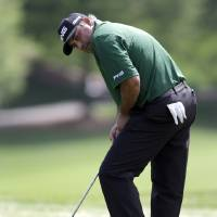 Photo - Angel Cabrera, of Argentina, reacts as he misses a putt on the 15th hole during the first round of the Wells Fargo Championship golf tournament in Charlotte, N.C., Thursday, May 1, 2014. (AP Photo/Bob Leverone)