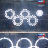 Photo - In a combo of frame grabs taken from Russian television, five snowflakes float together in Fisht Stadium during the opening ceremony of the 2014 Winter Olympics in Sochi, Russia, Friday, Feb. 7, 2014. During the live ceremony, the fifth ring failed to fully open to create the Olympics rings. On Russian television, producers inserted footage from a dress rehearsal when all five rings joined together and erupted in pyrotechnics.(AP Photo)