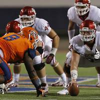Photo - Oklahoma Sooners offensive linesman Gabe Ikard (64) lines up as center in front of UTEP's Marcus Bagley (8) during the college football game between the University of Oklahoma Sooners (OU) and the University of Texas El Paso Miners (UTEP) at Sun Bowl Stadium on Saturday, Sept. 1, 2012, in El Paso, Texas.  Photo by Chris Landsberger, The Oklahoman