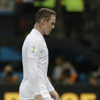 Photo - England's Wayne Rooney leaves the pitch after the group D World Cup soccer match between England and Italy at the Arena da Amazonia in Manaus, Brazil, Saturday, June 14, 2014. Italy won the match 2-1.  (AP Photo/Matt Dunham)