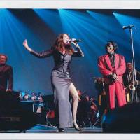 Photo - Kelly Jarrell Gordon performs in concert with James Brown. Photo provided.