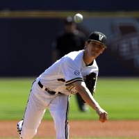 Photo - Walker Buehler pitches for Vanderbilt against Tennessee during the Southeastern Conference NCAA college baseball tournament on Tuesday, May 20, 2014, in Hoover, Ala. (AP Photo/Butch Dill)