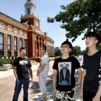 Photo -  International students, from left, Steve Jian, Peng Yu, Felix Huang and Yun Ye Gou, stand outside the Edmon Low Library last week as they become familiar with the Oklahoma State University campus. The students are freshmen from China pursuing degrees in finance and business. Photo by Jim Beckel, The Oklahoman   Jim Beckel -  THE OKLAHOMAN