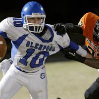 Photo - Glenpool's Connor Ferrell tries to get away from Douglass' Erik King (CQ)during their game at Moses F. Miller Stadium at Douglass High School in Oklahoma City on Friday, Oct. 29, 2010. Photo by John Clanton, The Oklahoman