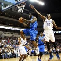 Photo - Dallas Mavericks' Jae Crowder shoots past Oklahoma City Thunder's Kevin Durant during their preseason NBA basketball game, Wednesday, Oct. 24, 2012, in Wichita, Kan. (AP Photo/The Wichita Eagle, Jaime Green) LOCAL TV OUT; MAGS OUT; LOCAL RADIO OUT; LOCAL INTERNET OUT ORG XMIT: KSWIE103