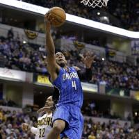 Photo - Orlando Magic guard Arron Afflalo gets a bucket on a fast break in front of Indiana Pacers guard George Hill in the first half of an NBA basketball game in Indianapolis, Monday, Feb. 3, 2014. (AP Photo/Michael Conroy)