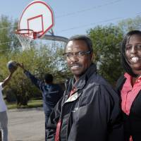 Photo -  Priscilla Meadows and her brother, the Rev. Krizzo Meadows, senior pastor of Christ Temple Community Church, pose for a photo at the church's outdoor basketball court. Photo by Sarah Phipps, The Oklahoman   SARAH PHIPPS
