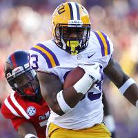 Photo -   LSU running back Jeremy Hill (33) rushes past Mississippi defensive back Trae Elston (7) on a 27-yard touchdown carry during the first half of their NCAA college football game, Saturday, Nov. 17, 2012, in Baton Rouge, La. (AP Photo/Gerald Herbert)