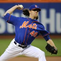 Photo - New York Mets starter Jacob deGrom (48) pitches against the Philadelphia Phillies in the first inning of a baseball game at Citi Field on Friday, Aug. 29, 2014, in New York. (AP Photo/Kathy Kmonicek)