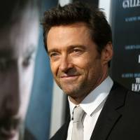 Photo - FILE - In this Sept. 12, 2013 photo, Hugh Jackman arrives at the premiere of