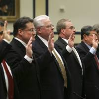 Photo - Airline safety officials are sworn in on Capitol Hill in Washington, Thursday, April 3, 2008, prior to testifying before the House Transportation and Infrastructure Committee hearing on FAA safety oversight of airlines. From left are,  Charalambe