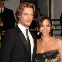 Photo - FILE - In this Feb. 22, 2009 file photo, model Gabriel Aubry, left, and actress Halle Berry arrive at the Vanity Fair Oscar party in West Hollywood, Calif. Attorneys for Halle Berry and her ex-boyfriend, Aubry, have settled court issues that arose after a Nov. 22, 2012 Thanksgiving Day fight at the actress' home. (AP Photo/Evan Agostini, File)