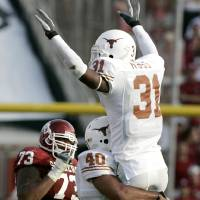 Photo - RED RIVER RIVALRY / COLLEGE FOOTBALL: Aaron Ross and Alex Spears of Texas celebrate in front of Brandon Walker of OU after an interception in the second half during the University of Oklahoma Sooners (OU) college football game against the University of Texas (UT), in the Red River Shootout at the Cotton Bowl, on Saturday, Oct. 7, 2006, in Dallas, Texas.    by Bryan Terry, The Oklahoman  ORG XMIT: KOD