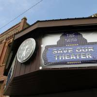 Photo - The front of the Time Theater is shown Feb. 7 in Stigler. The community is working to raise the $100,000 needed to convert the theater to digital projection and keep its doors open. Photos by Nate Billings, The Oklahoman