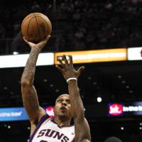 Photo -   Phoenix Suns' Shannon Brown (26) scores over Portland Trail Blazers' Wesley Matthews during the second half of an NBA basketball game, Wednesday, Nov. 21, 2012, in Phoenix. (AP Photo/Ross D. Franklin)