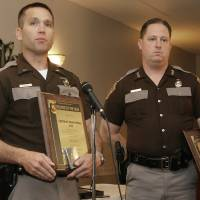 Photo - Trooper of the Year winners Lieutenant Brian Sturgill and Trooper Joe Howard with their awards for a helicopter rescue during last year's flooding, Thursday, April 3, 2008.  Photo by DAVID MCDANIEL, THE OKLAHOMAN.    ORG XMIT: KOD