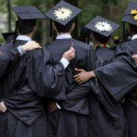 Photo -   Graduates pose for photographs May 20 during commencement at Yale University in New Haven, Conn.  AP File Photo   Jessica Hill -