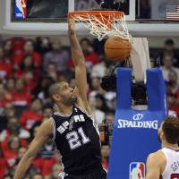 Photo -   San Antonio Spurs center Tim Duncan dunks as Los Angeles Clippers forward Blake Griffin during the first half in Game 4 of an NBA basketball playoffs Western Conference semifinal, Sunday, May 20, 2012, in Los Angeles. (AP Photo/Mark J. Terrill)