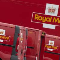 Photo - Royal Mail vans lined up at London's largest sorting office Mount Pleasant, Thursday, Sept. 12, 2013. The U.K. coalition government has confirmed plans to privatize the country's 500-year-old Royal Mail this fall. Business Secretary Vince Cable said Thursday an initial public offering of a majority stake in the postal service was scheduled for the coming weeks. (AP Photo/Alastair Grant)