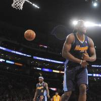 Photo -   Los Angeles Lakers' Andrew Bynum, left, celebrates a basket as Denver Nuggets' Kenneth Faried reacts to a foul call during the first half of a NBA first-round playoff basketball game in Los Angeles, Tuesday, May 1, 2012. (AP Photo/Chris Carlson)