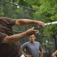 Photo - Danny Batisa misses the ball during a game of stickball in East Harlem, N.Y., Friday, July 12, 2013. Six players are being inducted into the Stickball Hall of Fame by a committee of so-called old timers who have been following the famous urban sport since its heyday in the 1940s and 50s. (AP Photo/Bethan McKernan)
