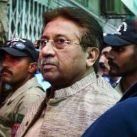 Photo - FILE - In this April 20, 2013, file photo, Pakistan's former President and military ruler Pervez Musharraf arrives at an anti-terrorism court in Islamabad, Pakistan. A Pakistani court Tuesday indicted Musharraf on murder charges in connection with the 2007 assassination of iconic Pakistani Prime Minister Benazir Bhutto, deepening the fall of a once-powerful figure who returned to the country this year in an effort to take part in elections. (AP Photo/Anjum Naveed, File)