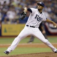 Photo - Tampa Bay Rays starting pitcher David Price delivers to the Toronto Blue Jays during the fourth inning of a baseball game Monday, March 31, 2014, in St. Petersburg, Fla. (AP Photo/Chris O'Meara)