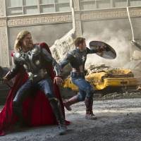 Photo - Thor (Chris Hemsworth) and Captain America (Chris Evans) join forces in Marvel's The Avengers.  Marvel photo.  Zade Rosenthal