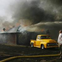 Photo -  FIRES: Paul Norwood watches helplessly as his neighbor's home is destroyed by wildfires in eastern Oklahoma County Thursday, April 9, 2009.  These homes are in Oakwood East housing addition, near SE 15 and Westminster. Photo by JIM BECKEL, THE OKLAHOMAN ORG XMIT: KOD