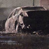 Photo - This image taken from video provided by ABC-TV shows officials at the site of a fiery single-vehicle crash Saturday Sept. 28, 2013 that killed 5 people in Burbank, Calif. There was one survivor found about 50 yards from the burning Nissan when police arrived on the scene around 4 a.m. Officials said speed appeared to be a factor in the crash.  (AP Photo/ABC-TV)