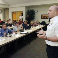 Photo - Fire Chief Jake Rhoades asks more than 50 community leaders for help in creating a five-year strategic plan for the Edmond Fire Department. PHOTO BY PAUL HELLSTERN, THE OKLAHOMAN
